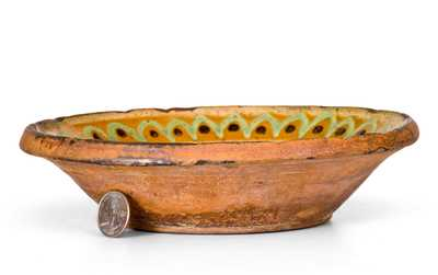 Rare Small-Sized Redware Bowl with Three-Color Slip Decoration, Hagerstown, MD, early 19th century.