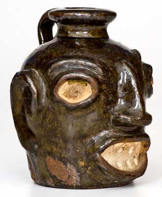 Rare Alkaline-Glazed Stoneware Face Jug, attributed to Miles Mill, Edgefield District, SC, circa 1865-1875.