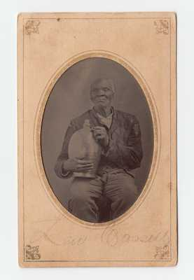 Very Rare Tintype Portrait of an African-American Man Holding a Stoneware Jug, American, circa 1865
