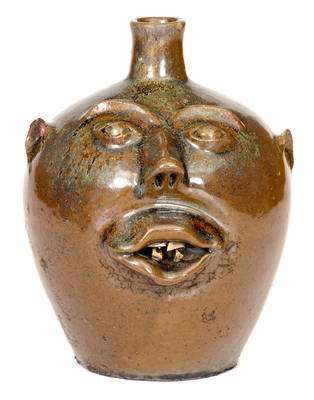 BROWN POTTERY Face Jug w/ Rutile in the Glaze