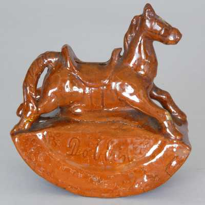 Probably Pennsylvania Redware Rocking Horse Bank