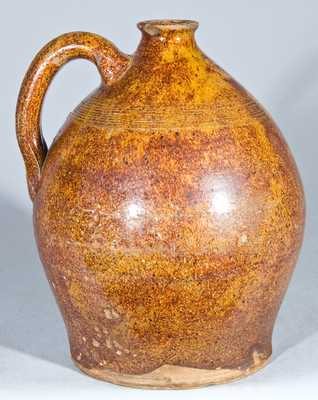 Glazed Redware Jug, New England origin.