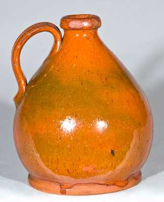 Small Glazed Redware Jug, probably New England origin