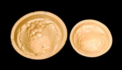 Two Yellowware Grape Molds