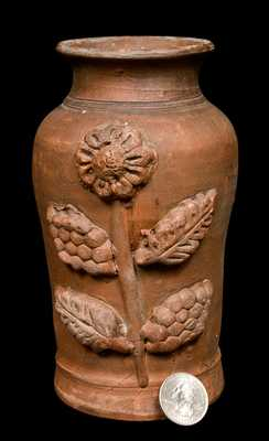 Redware Vase with Applied Floral Decoration.