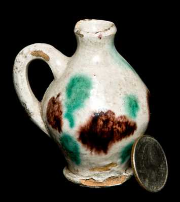 Miniature Redware Jug with Multi-Colored Glaze
