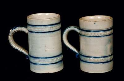 Lot of Two: Molded Stoneware Mugs Signed