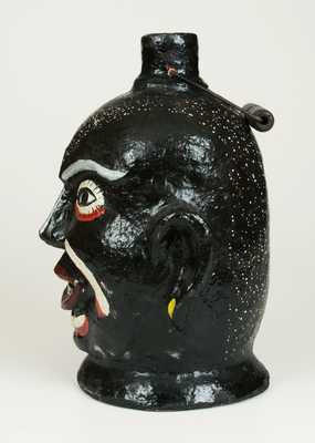 Very Rare Cold Painted Face Jug with Elaborate Speckled Painting