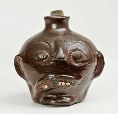 Very Rare Stoneware Face Jug with Rat Tail Handle, attributed to Guy Daugherty, Bethune, SC, circa 1950