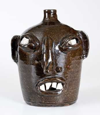 Stoneware Face Jug with Quartz Eyes and China Teeth, Southern US, 20th century