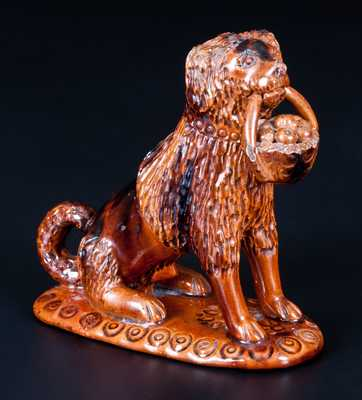 Glazed Pennsylvania Redware Figure of a Dog with Basket