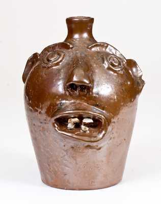 Stoneware Face Jug, Stamped