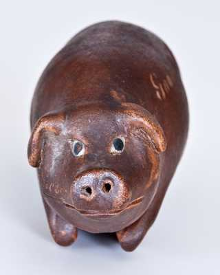 Early Albany-Slip-Glazed Anna Pottery Stoneware Pig Flask, Wallace and Cornwall Kirkpatrick, Anna, IL, circa 1870. This example features the incised inscription,