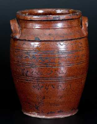 Rare Glazed Southern Redware Jar with Elaborate Incised Sine-Wave Decoration, attributed to the Henkel-Spigle Pottery, Botetourt County, VA, circa 1830-1850. H 10 1/8