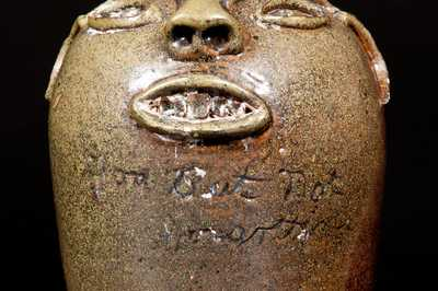 Extremely Rare Stoneware Face Jug with Inscription