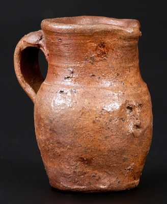 Miniature Stoneware Pitcher with Hand-Modeled Face Under Spout