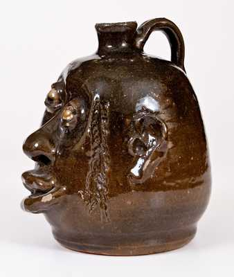 Unusual Alkaline-Glazed Stoneware Face Jug, Signed