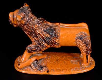 Exceedingly Rare Pennsylvania Redware Figure of a Lion Standing atop a Bird