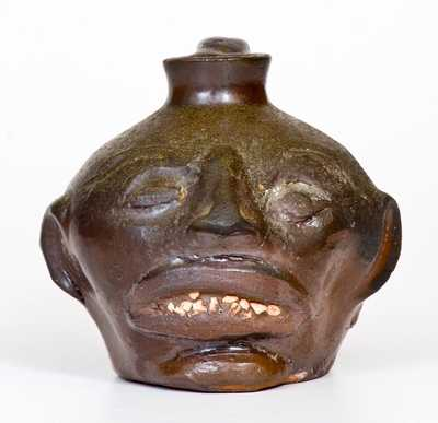 Rare Guy Daugherty, Bethune, Kershaw County, South Carolina Stoneware Face Jug, c1950
