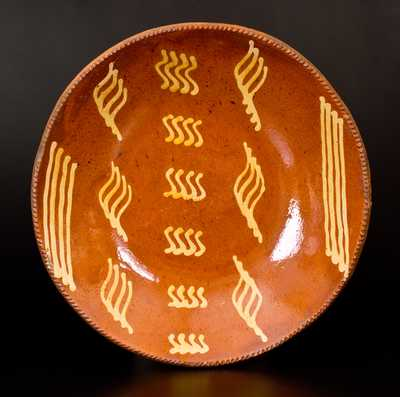 Outstanding Slip-Decorated Redware Charger, Philadelphia, PA origin, early to mid 19th century.