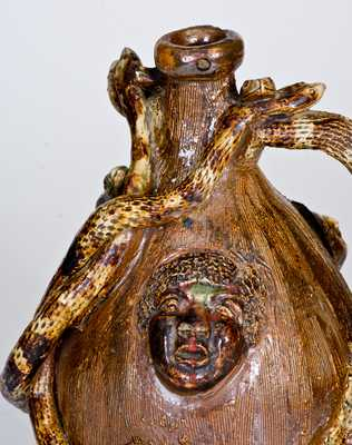 Outstanding Stoneware Temperance Jug with Applied Snakes, Animals, and Human Faces