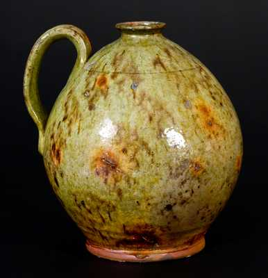 Exceptional Glazed Redware Jug, New England origin, circa 1825