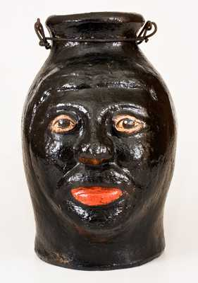 Painted Stoneware Face Jug with Bail Handle, North Wilkesboro, NC origin, circa 1925